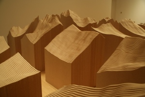 """Maya Lin, Blue Lake Pass, 2006. Duraflake particleboard. 20 blocks, 3' x 3' each; 5' 8"""" x 17' 6"""" x 22' 5"""" overall. Courtesy of the artist and PaceWildenstein. Photo by Colleen Chartier."""