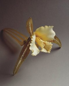 René Lalique (French, 1860-1945). Cattleya Orchid Hair Ornament. Carved ivory, horn, gold, enamel on gold, diamonds, 1903-1904. Private collection. Photo: Laurent Sully Jaulmes. © Artists Rights Society (ARS), New York/ADAGP Paris.