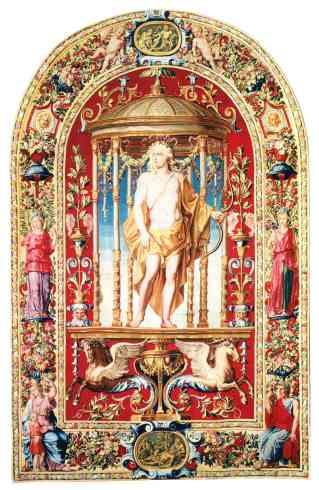 """This tapestry with its rare arched top depicts Lois XIV as Apollo and was woven for his private quarters at Trianon.  """"Apollo,"""" from the series """"Tenture des Mois Arabesques,"""" ca. 1697 Gobelins Manufactory. After Noël Coypel (French, Paris 1628–1707 Paris), painter.  Workshop of Jean de la Croix (French, 1662–1712), Wool and silk, 110 1/4 x 87 in. (280 x 221 cm). Musée du Louvre.  Photo: © RMN-Grand Palais / Art Resource, NY."""