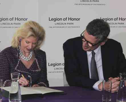 Henri Loyrette, director of the Musée du Louvre, looks on as Diane B. Wilsey, president of the Board of Trustees of FAMSF, signs an accord on November 15, 2012, which paves the way for more collaboration between the two museums and a series of exhibitions bringing artworks from Louvre to San Francisco and works from FAMSF to Paris for exhibition.  Photo: Geneva Anderson