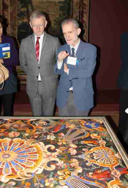 "Martin Chapman (left), Curator in Charge of European Decorative Arts at the Fine Arts Museums of San Francisco, and Marc Bascou (right), Director of Département des Objets d'art at the Musée du Louvre, discuss a rare 17th century marble and pietre dure (hardstones) tabletop with emblems of Louis XIV, exotic parrots and ornate garlands of fruits and flowers. Chapman and Bascou conducted the November 15, 2012 media preview for ""Royal Treasures from the Louvre: Louis XIV to Marie-Antoinette.""  Photo: Geneva Anderson"