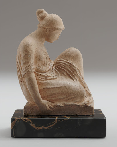"""Aristide Maillol, """"Seated Woman with Chignon,"""" 1900, Terracotta on black marble base, 6 7/8 x 4 x 5 inches, The William S. Paley Collection, courtesy of MoMA."""