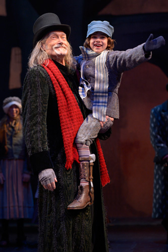 "In A.C.T.'s annual holiday favorite, ""A Christmas Carol,"" James Carpenter (L) is Ebenezer Scrooge and Carmen Steele (R) is Tiny Tim Cratchit.  Runs November 30–December 24, 2012, at A.C.T.'s Geary Theater. Photo by Kevin Berne."