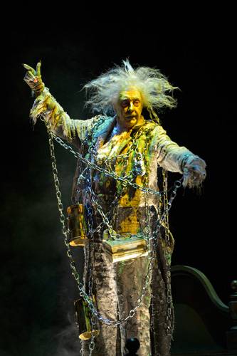 The Ghost of Jacob Marley (Ken Ruta) haunts Scrooge on Christmas Eve to save his soul, warning him of the three other ghosts that will visit him. Photo: Kevin Berne