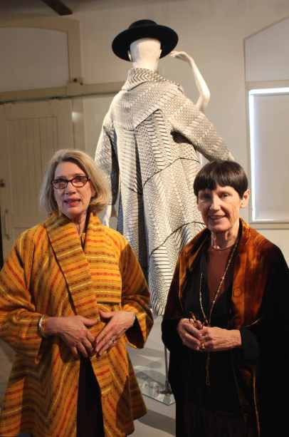 Sandra Ericson, founder of the Center for Pattern Design, and artist Candace Crockett at the Petaluma Arts Center.  Ericson wears a bias-cut coat she designed using the draping techniques of 1930's pattern designer Madeleine Vionnet.  Crockett wears a jacket designed by Ericson in discharged silk velvet.  Behind them is a bias-cut swing coat designed by Ericson created from Crockett's hand-loomed wool.   Photo: Geneva Anderson