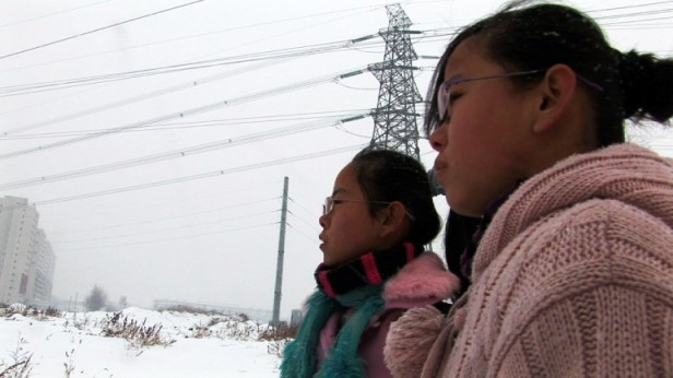 "Two young Chinese girls from a migrant family that has relocated to a big city struggle to earn money to pay for their brother's schooling and are forced to abandon their own studies, putting their futures in jeopardy in ""When the Bough Breaks,"" directed by Ji Dan, one of China's preeminent female documentary filmmakers.   Celebrated Chinese artist, Hung Liu, will lead a conversation following the film's March 21, 2013 screening at the New People Cinema at CAAMFest 2013.  Image: CAAMFest"