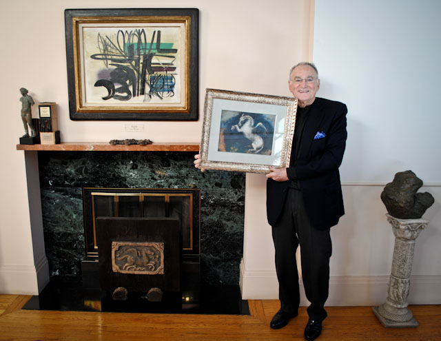 "Jan Shrem of Clos Pegase Winery with painting ""Pegasus"" by Odilon Redon.  Photo: courtesy Napa Valley Museum"