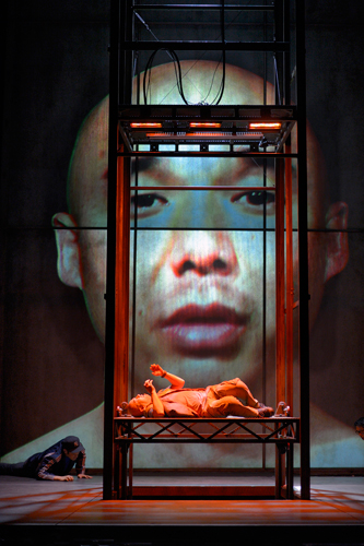 "In ""Stuck Elevator,"" which has its world premiere at A.C.T., Julius Ahn is Chinese deliveryman Guāng who gets stuck in an elevator for over three days and starts to hallucinate.  The musical-theatre-opera hybrid runs April 4 – 28, 2013, at A.C.T.'s Geary Theater. Photo by Kevin Berne"