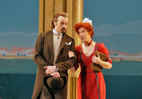 Don Alfonso (bass Marco Vinco, left) conspires with the maid Despina (former Adler Fellow, soprano Susannah Biller) to prove to Ferrando and Guglielmo that their two young fiancées are completely fickle and incapable of fidelity, as all women are.  Photo: Cory Weaver, courtesy San Francisco Opera.