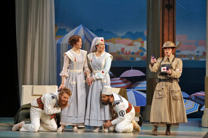 From L to R—Philippe Sly (Guglielmo), Christel Lötzsch (Dorabella), Ellie Dehn (Fiordiligi), Francesco Demuro (Ferrando)and Susannah Biller (Despina) in a scene where Despina disguised as a doctor uses an invention to draw out poison and urges the sisters to nurse their two patients (their fiancées who are disguised as Albanian sailors) back to health.  Photo: Cory Weaver, courtesy San Francisco Opera.
