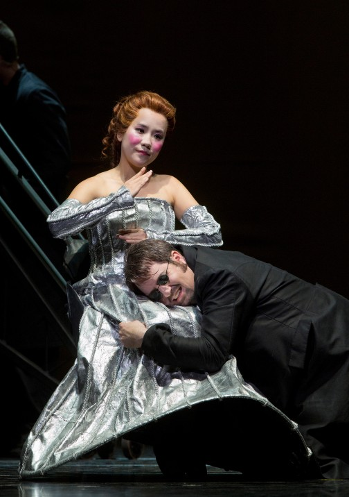 "Korean soprano Hye Jung Lee as the mechanical doll, Olympia, and tenor Matthew Polenzani as Hoffmann in SF Opera's ""The Tales of Hoffmann.""  Photo  ©Cory Weaver/San Francisco Opera."