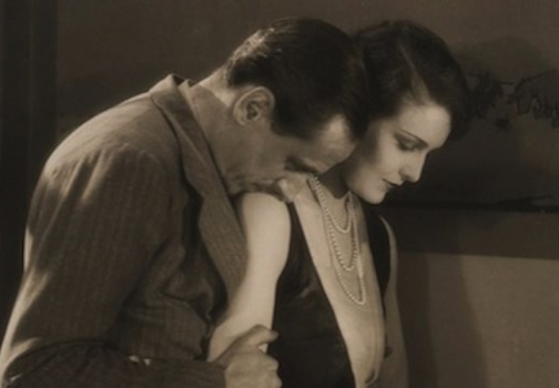 "Actor, writer, and producer Miles Mander plays British politician Sir Hugo Boycott and Madeleine Carroll is Lady Madeleine Boycott in ""The First Born,"" 1928.  The film touches on the very adult themes of infertility and adultery and the disintegration of a marriage in a wealthy British upper-class milieu.  Image: courtesy BFI."