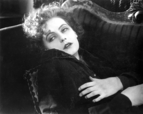 "In G.W. Pabst's ""The Joyless Street"" (1925), two women from the same poor neighborhood try to better themselves during the period of Austrian postwar hyperinflation.  Marie becomes a prostitute while Grete (Greta Garbo in her final European film before she was snapped up by MGM in Hollywood) does not.  Photo: courtesy Filmmuseum München"