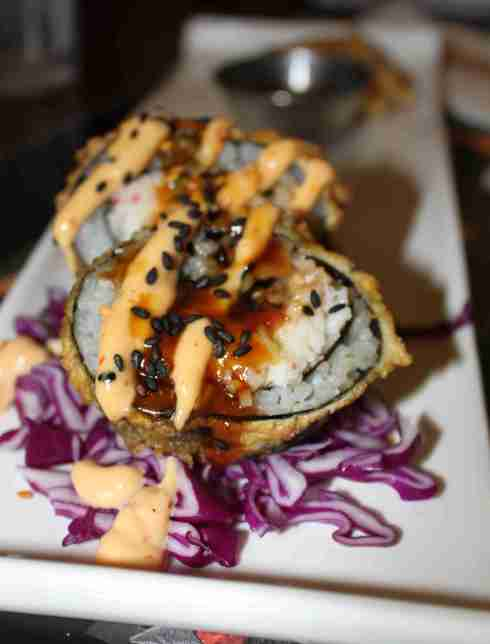 Chef/owner Andy Ma of Andy's Kitchen & Sushi Bar, at 212 Western Avenue, is a new to Taste of Petaluma and will serve his signature Samurai Roll (Crab, Avocado, Unagi; deep fried; topped with spicy mayo and unagi sauce) and (not pictured) Mini Corn Sticks w/ Thai Sweet Chili Dip. Don't miss his walls, which are always packed with interesting local art.  Photo:  Geneva Anderson