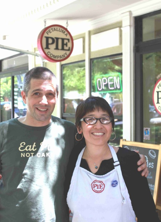 "Pie Powered Petaluma Couple—Angelo Sacerdote and Lina Hoshino.  Petaluma Pie Company keeps them hopping but Lina Hoshino is also an award-winning documentary filmmaker whose films have screened at festivals all over the world.  Her latest doc, ""Living Along the Fenceline""  (Best Documentary Feature at Female Eye Festival 2013) focuses on women grassroots activists living in communities that have been adversely impacted by military bases they host.  Photo:  Geneva Anderson"