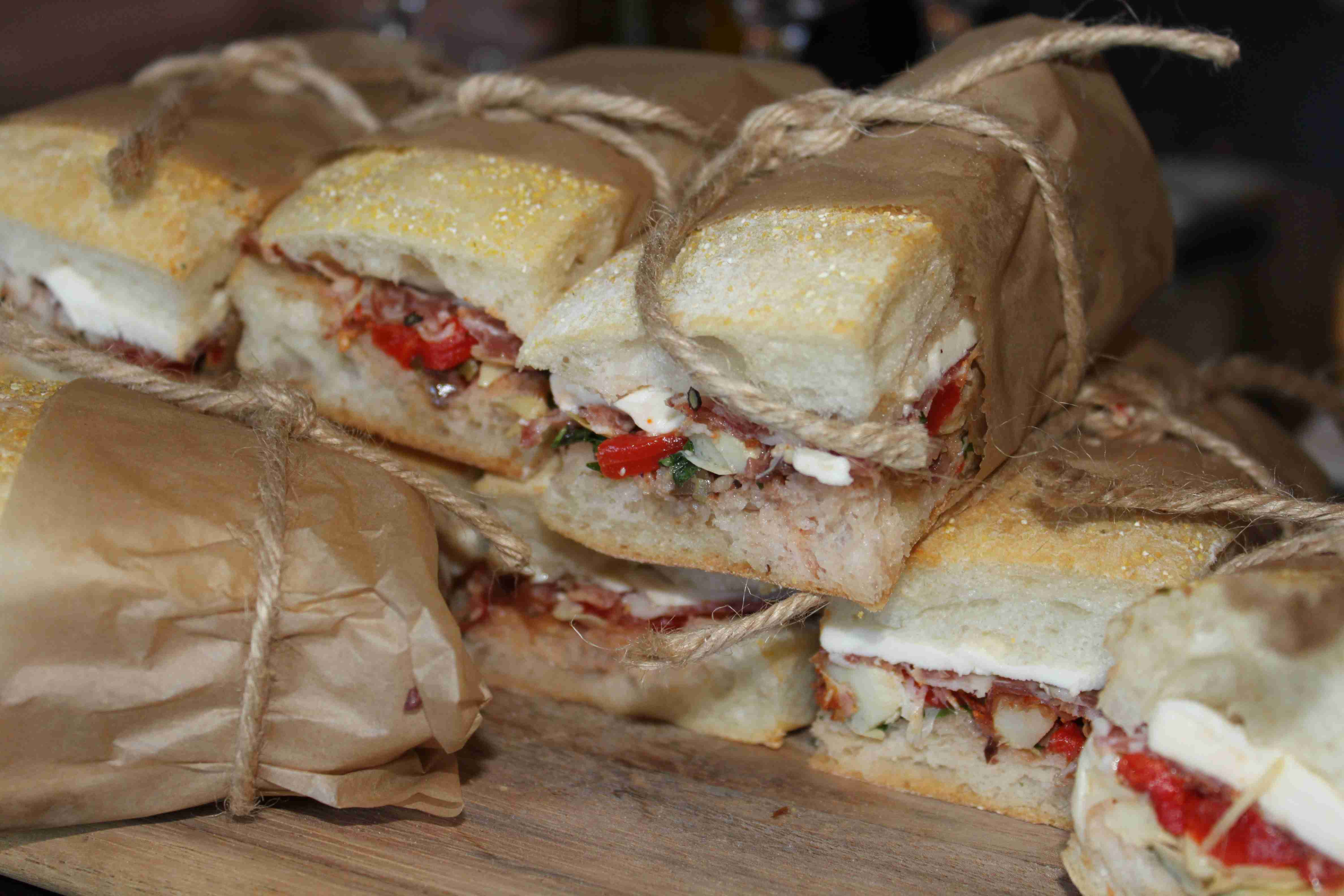 Ciabatta Muffaletta Sandwich with made in-house Spicy Coppa, Fennel ...