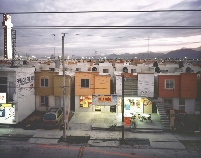 "9.Questions of land use and urban development pervade the work of contemporary Mexican photographer Alejandro Cartagena.  The stillness belies the violence that has a vice-grip on Mexico's northern cities as the drug war has relocated to the suburbs. ""Business in a Newly Built Suburb in Juarez,"" from the series Suburbia Mexicana, 2009; inkjet print; 15 3/4 in. x 20 in.; Collection SFMOMA, Accessions Committee Fund purchase; © Alejandro Cartagena"