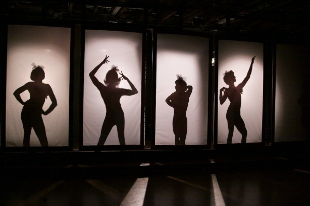 "Cinnabar Theater has sold so many tickets for its risqué production of ""La Cage aux Folles"" that it has extended the musical through November 10, 2013.  The exotic Cagelles make their first appearance as mysterious silhouettes behind transparent screens.  Photo: Eric Chazankin)"