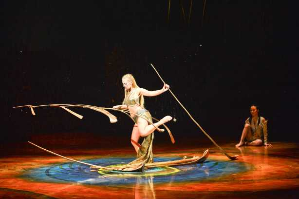 """""""Amaluna's"""" most evocative performance comes from the Balance Goddess (Lara Jacobs) who  builds a 45 pound Calder-like mobile from thirteen huge palm leaf ribs that are held in balance by the weight of a feather.  Costume credit: Mérédith Caron; Photo: Laurence Labat, Cirque de Soleil"""