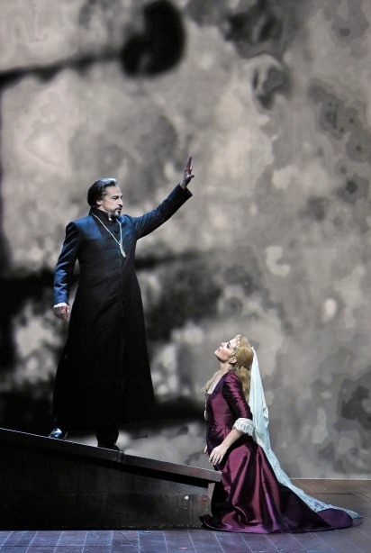 """American baritone Greer Grimsley is the Dutchman and American soprano Lise Lindstrom has her San Francisco Opera debut as Senta in Richard Wagner's """"The Flying Dutchman,"""" at SFO through November 15, 2013.  The production underwent a dramatic scenic overhaul with the last minute firing of its director/set designer and features bold video projections of turbulent waves, leaping flames and a myriad of abstract images.  Photo: Cory Weaver, SFO"""