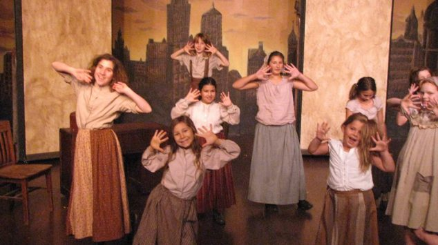 "An adorable cast of orphans, who auditioned for their roles in August 2013, complete the cast of Cinnabar's ""Annie,"" on stage at Petaluma's Cinnabar Theater through December 15, 2013.  Image: courtesy Cinnabar Theater."