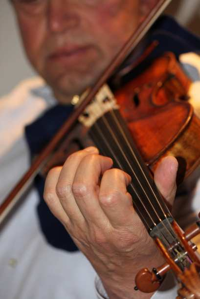 "It took SFS Concertmaster Alexander Barantschik about a year to get comfortable with ""David,"" the famous1742 Guarnerius del Gesú that was Jascha Heifetz' favorite fiddle on stage and in the recording studio.   Barantschik admires the way sound projects from the violin so that even while he is playing softly, the instrument can be heard throughout the concert hall.  The violin rarely leaves Davies Symphony Hall, EXCEPT when it travels to the Green Music Center or to the Mondavi Center.  Photo: Geneva Anderson"
