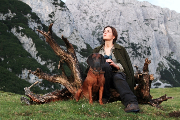 "As the only human survivor after an unexplained global tragedy, German actress Marina Gedeck bonds tightly with her loyal dog in Julian Roman Pölsler's ""The Wall"" a film that is true to Marlen Haushofer's exceptional novel . Image: courtesy of Music Box Films"