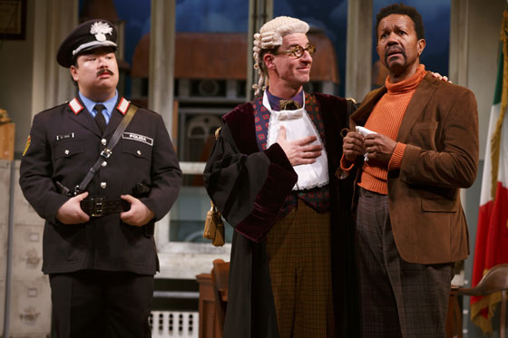 "In Dario Fo's comedy, ""Accidental Death of an Anarchist,"" now at Berkeley Rep, Maniac (Steven Epp) (center) impersonates a judge and interrogates quack Constable (Eugene Ma, left) and dim-witted Inspector Pissani (Allen Gilmore) and catches them in a lie about a death that occurred at the police station."