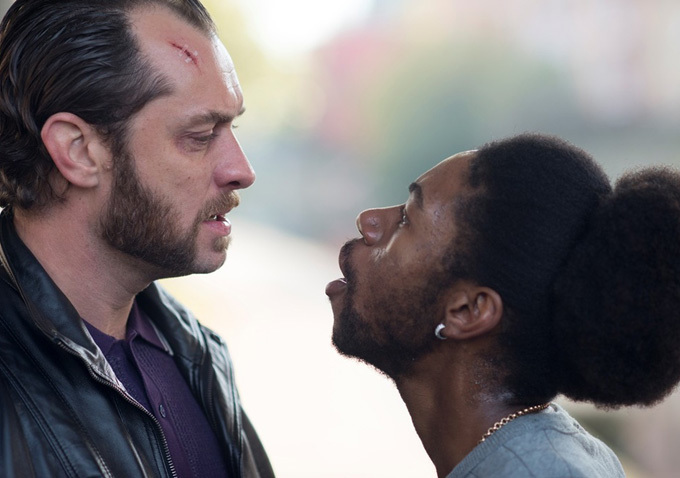"""Jude Law (L) and Nathan Stewart-Jarrett (R) in a scene from Richard Shepard's """"Dom Hemingway"""" (2014), one of two opening night feature films at the 17th Sonoma International Film Festival.  Just released from prison after taking the fall for his boss, Dom comes after the money he's owed for keeping silent and protecting his boss Fontaine (Damian Bechir).  Brash, volatile, profane and angry, this is Jude Law at his complicated best.  Image: Foxlight"""