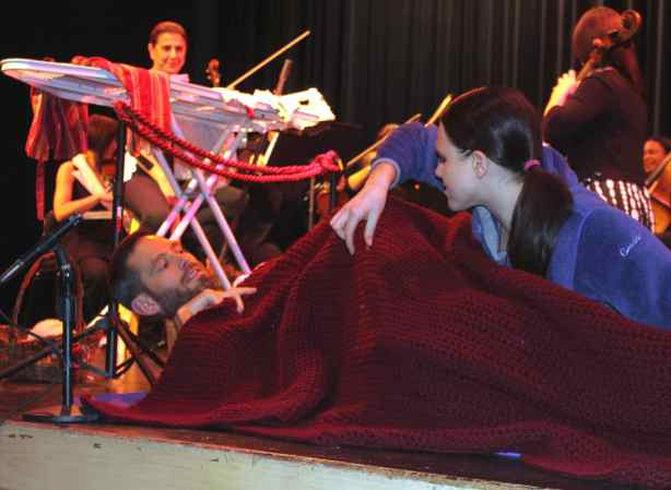 "Former Adler, tenor Thomas Glenn (wrapped in blanket) and current Adler, soprano, Maria Valdes, prepare for their performance in Donizetti's comedic opera, ""Rita,"" with the New Century Chamber Orchestra (NCCO).  Music Director Nadja Salerno-Sonnenberg watches from behind the ironing board.  The Adler residency offers many performance opportunities. Photo: Geneva Anderson"