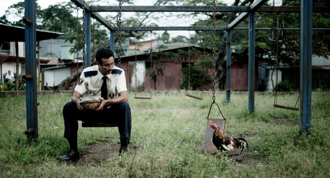 """Costa Rican director, Neto Villalobos' debut feature comedy """"All About the Feathers,"""" (2013), is about a security guard who is obsessed with fighting cocks and  acquires and befriends a rooster he names """"Rocky.""""  Villalobos used a small crew of nonprofessional actors and no roosters are shown fighting.  Photo: courtesy San Francisco Film Society"""