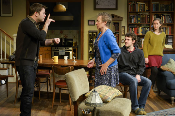 "A scene from Nina Raine's critically acclaimed family drama ""Tribes,"" at Berkeley Rep through May 18, 2014.  (From L to R) Billy (James Caverly) was born deaf but never learned sign language.  His hearing family—mother Beth (Anita Carey), brother Daniel (Dan Clegg), sister Ruth (Elizabeth Morton) and fiercely outspoken father (not shown)—have always belittled sign language and refused to accommodate him or to accept his deafness.  When Billy meets Sylvia, who hears but is slowly going deaf and who was raised in a deaf family, he comes out of his shell and embraces some of the rituals of the deaf, upending his entire family.  Photo: courtesy Mellopix.com"