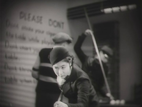 """Pool playing is a prominently featured in Japanese director Yasujiro's Ozu's """"Dragnet Girl"""" (""""Hijosen No Onna,"""" 1933) screening Sunday at noon.  Ozu, a fan of American films, pays homage to the genre, filling the frame with Hollywood-style décor and costumes, moody lighting and classic elements of film noir, including a trapped hero. The sets and cinematography were reportedly influenced by the work of Joseph von Sternberg.  Kinuyo Tanaka, who later went on to star in almost all of Mizoguchi's movies, is charming in one of her earlier film roles—an ultra modern Yokohama office girl by day and gun-toting tough heroine by night.  She has a heart of gold, moral fiber, and the reformist zeal of a Salvation Army crusader, even if she shoots her man in the foot to teach him a lesson."""