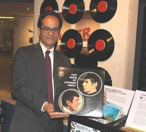 "OMCA Senior Curator of Art René de Guzman holds a rare copy of Nimoy's hit lp ""Two Sides of Leonard Nimoy,"" (Dot Records, 1967)  that features tracks —""Highly Illogical,"" ""Spock Thoughts,"" ""Follow Your Star,"" ""Once I Smiled.""   Listening to Ninoy talk/sing is a thoroughly eyebrow raising listening experience, courtesy of ""Vinyl"" at OMCA through July 27, 2014.  Photo: Geneva Anderson"