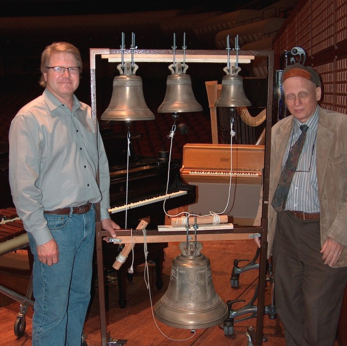 "San Francisco Symphony regular guest percussionist Victor Avdienko (left) will play a ""peal"" or set of authentic Russian bronze bells in the Symphony's ""All Tchaikovsky"" concert this Saturday at Weill Hall and lawn.  This marks the SFS' first use of authentic Russian bells in a performance.  The peal has been loaned to SFS by the St. Nicholas Orthodox Church of San Anselmo.  Mark Galperin (right), General Manager of Blagovest Bells of Marin, organized the loan, ensured the bells were installed properly on their rack for Saturday's concert, and helped Avdienko select the right mallet to approximate the sound extracted by an actual bell clapper.  The bells range in weight from 12.3 to 88.1 pounds and were made in 2012 by Pyatkov & Co. Bell foundry, a famous Russian bell foundry in Kamensky-Uralsy.  Photo: courtesy Blagovest Bells"