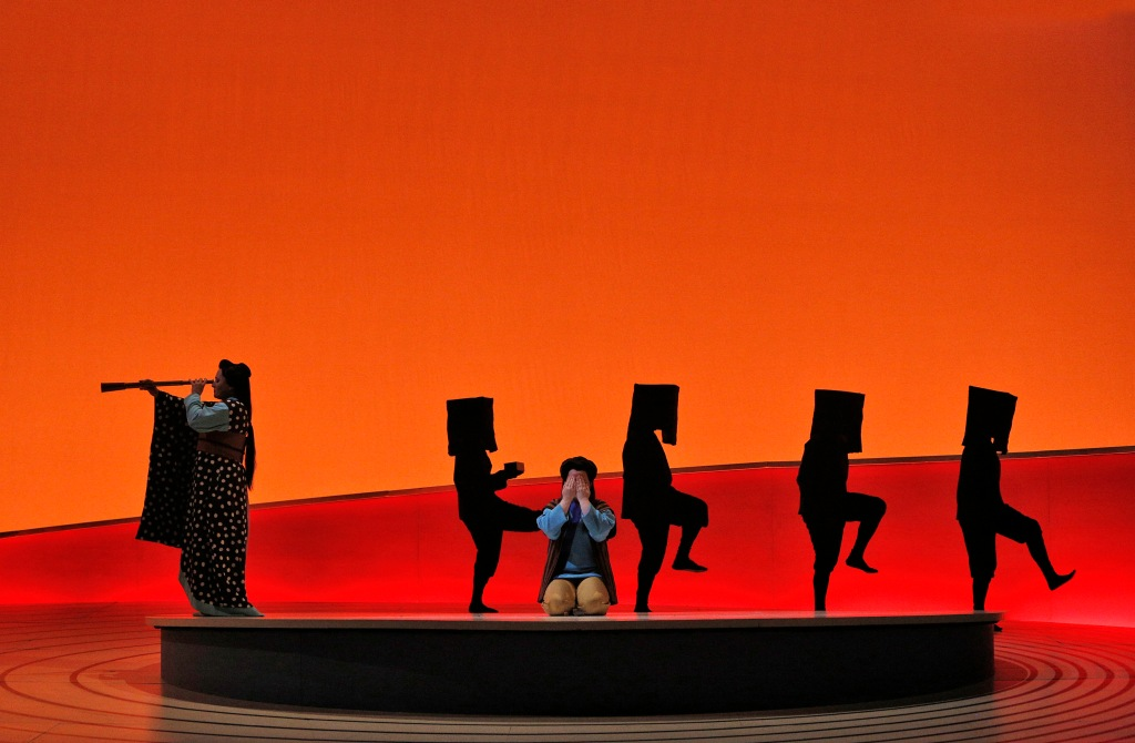 """Kaneko's sets and costumes are influenced by the conventions of classical Japanese theater, such as the use of black-dressed Kuroko which function as running crew to assist with scene changes.  In this vividly colored """"Butterfly,"""" they also played other minor roles not covered by fully costumed singers.  Photo: ©Cory Weaver/San Francisco Opera"""