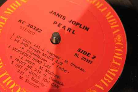 """Pearl,"" the second solo album by Janis Joplin, is just one of dozens of lp's that can be seen, touched and played at ""Vinyl,"" the Oakland Museum of California's homage to listening to, collecting, and sharing records.  ""Pearl"" was released posthumously on Columbia Records in January 1971 and was the last album that had Joplin's direct participation.  Its recording sessions ended with Joplin's death on October 7, 1970.  Soon after its release, it hit  #1 on the Billboard 200 and held the spot for nine weeks and was certified ""quadruple platinum"" by the Recording Industry Association of America. ""Pearl"" is the only Joplin album recorded with the Full Tilt Boogie Band, her final touring unit.  The album cover, photographed by Barry Feinstein in Los Angeles shows Joplin reclining on her Victorian era loveseat with a drink in her hand.  Photo: Geneva Anderson"