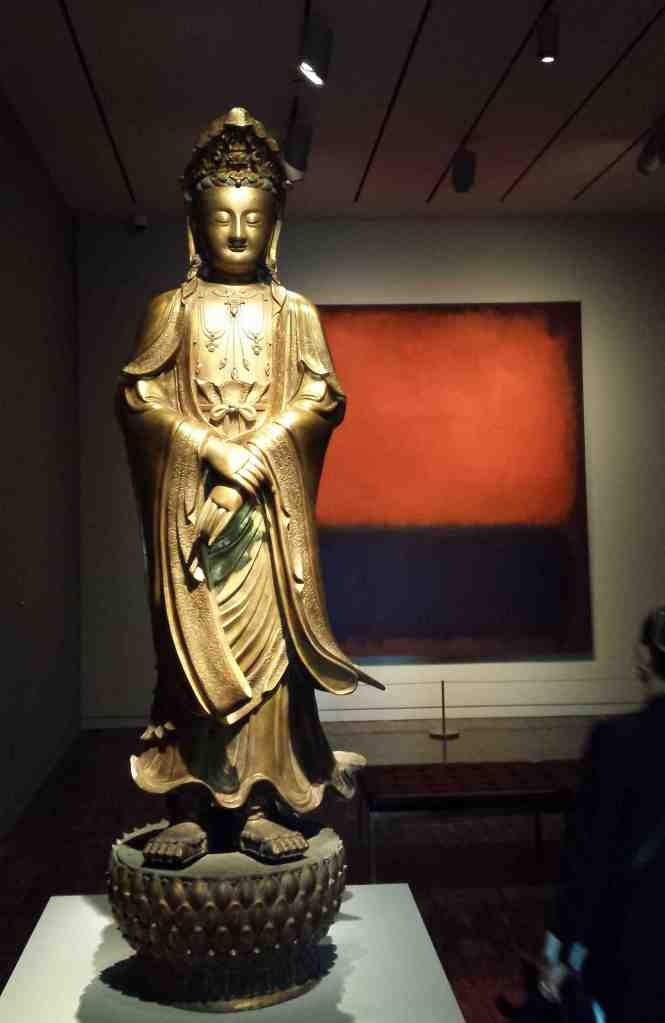 """In """"Gorgeous"""" at the Asian Art Museum through September 14, 2014, Mark Rothko's """"No. 14, 1960,"""" one of SFMOMA's most visited artworks, shares a small gallery with an exquisite 17th century Chinese bronze Buddha, whose robes seem blown by a soft breeze, and a 17th century Tibetan Buddhist mandala, all of which encourage very slow looking—the full extent of their gorgeousness is experienced through reflection over time.  """"Gorgeous"""" presents mostly Western modern and contemporary works from SFMOMA in conversation with artworks from AAM that span 2,000 years and many different cultures, opening up whole new ways of experiencing all of these works very much in the present moment.  Photo: Geneva Anderson"""