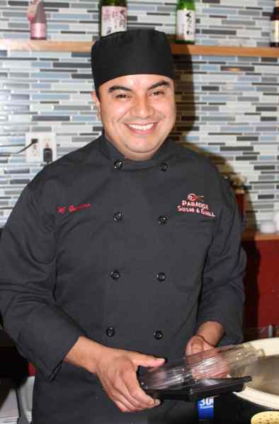 "Gustavo Martinez, chef and owner of Paradise Sushi in Petaluma's River Plaza, was trained by Japanese chefs in Lake Tahoe and has been a sushi chef for 16 years now.  After working in Santa Rosa, he opened is Petaluma restaurant in November 2012 and never looked back—his Petaluma clients are ""much nicer"" and his (sushi) bar is hopping on weekends. His ceviche roll, a creative shout out to his Mexican heritage, is a spicy fusion of salmon, serrano peppers, and avocado topped with several varieties of fish, red onions, wine, lime juice & cilantro. Photo: Geneva Anderson"