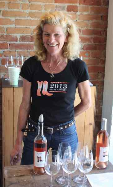 McEvoy Ranch's Winemaker, Margaret Koski Kent will be pouring McEvoy's 2013 Rosebud rosé at Thistle Meats which also stocks McEvoy's prized olives.  Kent initially headed McEoy's expansive gardens and then studied oenology at Napa Valley College and apprenticed in Italy.  She helped launch their expansion into wine.  With a nod to tradition and in pursuit of a wine that would complement their high-end virgin olive oil, McEvoy began to interplant grapes on its estate around 2006 and then dedicated several acres to separate vineyards for pinot noir, syrah pinot noir, syrah, grenache, viognier, alicante bouschet, refosco and Montepulciano. It then expanded to a Hicks Valley property with pinot noir clones. McEvoy is now producing several wines and winning awards and Kent could not be happier with her job.  Photo:  Geneva Anderson