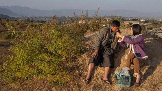 """Lashio, Myanmar is the setting for Midi Z's """"Ice Poison"""" (Bing Du) (2014) screening Saturday, October 11 at the 37th Mill Valley Film Festival.  Faced with a failing vegetable crop, an impoverished farmer pawns his cow for a moped and starts a taxi service in the city.  In six months, he must make enough to buy the cow back, or it will be slaughtered and sold for meat. His new venture is proving to be another failure until he picks up his first fare, a woman desperate to leave an arranged marriage in China and bring her son back to live with her. They team up in the only steady business in around—opium poppies.  The film balances moments of joy with the stark reality of a country re-emerging after decades of underdevelopment and repression.  Photo: courtesy MVFF"""