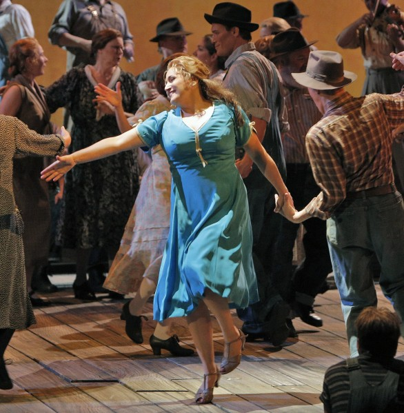 "Patricia Racette (blue dress) as Susannah, square-dancing at a church social in backwoods Tennessee in a new San Francisco Opera production of Carlisle Floyd's ""Susannah.""  edited Corey Weaver photo."