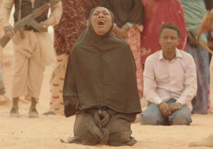 """Abderrahmane Sissako's """"Timbuktu"""" (2014) had its world premiere at the Cannes Film Festival where it received a 10-minute-long standing ovation.  Due to unrest in Mali, the film was shot in neighboring Mauritania.  The film is set in 2012 and tells the story of what happens when people living in northern Mali deal with and ultimately resist a jihadist takeover by some militant rebels.  Actor Ahmed Ibrahim will be in attendance at MVFF37.  Photo: courtesy MVFF"""