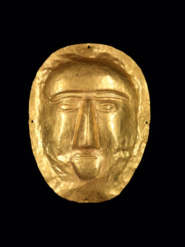 """A child's gold funerary mask, 1st century CE., from a royal tomb discovered in the summer of 1998, outside the city of Thaj, in northeastern Arabia.  It belonged to a young girl, about 6 years  old, who had been buried in  royal manner; her body was covered with gold, rubies, and pearls. The funerary objects buried with her, all datable to the first century CE, were decorated with Hellenistic motifs, which must have been imported.  This magnificent mask is one of 200 precious artifacts in """"Roads of Arabia,"""" at the Asian Art Museum through January 18, 2015. Courtesy of National Museum of Saudi Arabia, Riyadh, 2061."""