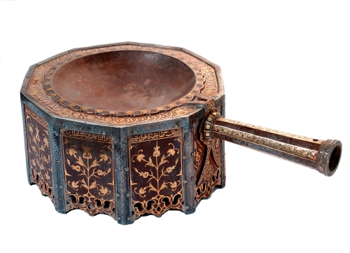 As the demand for incense declined around the first century, and maritime routes across the red Sea competed with land routes, previously vital incense roads were slowly replaced by pilgrimage roads converging on Mecca, Islam's spiritual center.  From the rise of Islam in the 7th century, pilgrimage trails led from major cities—Damascus, Cairo, Baghdad—to Mecca. This large incense burner (1649), with its delicate inlaid floral motif, was commissioned by the mother of the Ottoman Sultan Murad IV (reigned 1623-40), one of the most powerful royal women of the Ottoman dynasty.  Iron, gold, and silver, 14 cm H x 38 cm W. Courtesy: National Museum of Saudi Arabia, Riyadh, 2999.