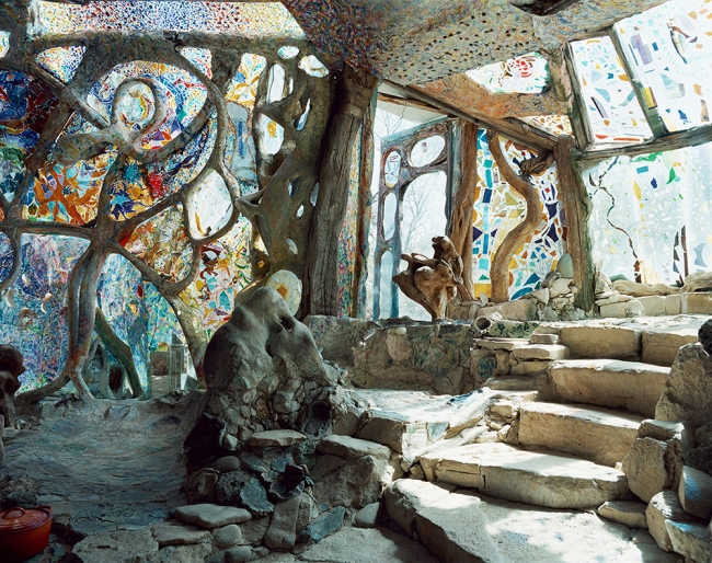 "An interior view of artists' Leda Levant and Michael Kahn's sculptural home, ""Eliphante"" in Cornville, Arizona (red rock country near Sedona).  The house is featured in Don Freeman's ""Art House,"" screening twice at the 18th Sonoma International Film Festival (March 25-29, 2015).  The gorgeously shot documentary explores the handmade homes crafted by and lived in by eleven American artists.  Levant and Kahn created their home over 28 years, entirely out of re-purposed materials and it evolved naturally form their mutual love of stone, wood, pottery and stained glass.  An elephant's trunk-like entrance to one of the structures gave rise to the name.   They began building their magical home when they first arrived in Arizona, even though they did not yet own the property."