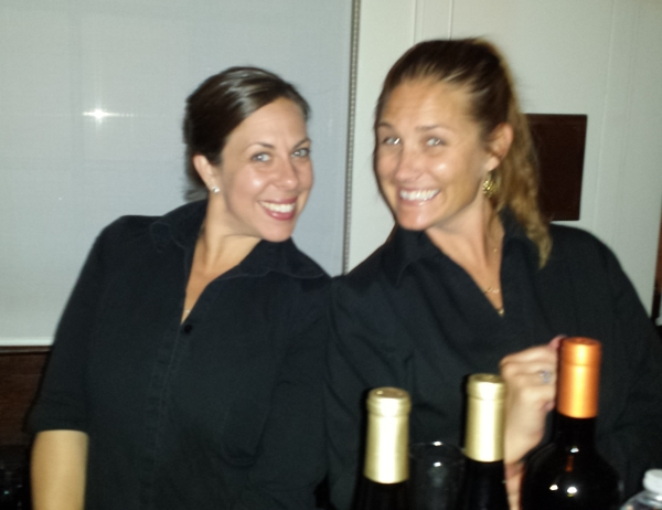 Christina Russo and Karen Anderson pouring bubbly and fine estate wines.