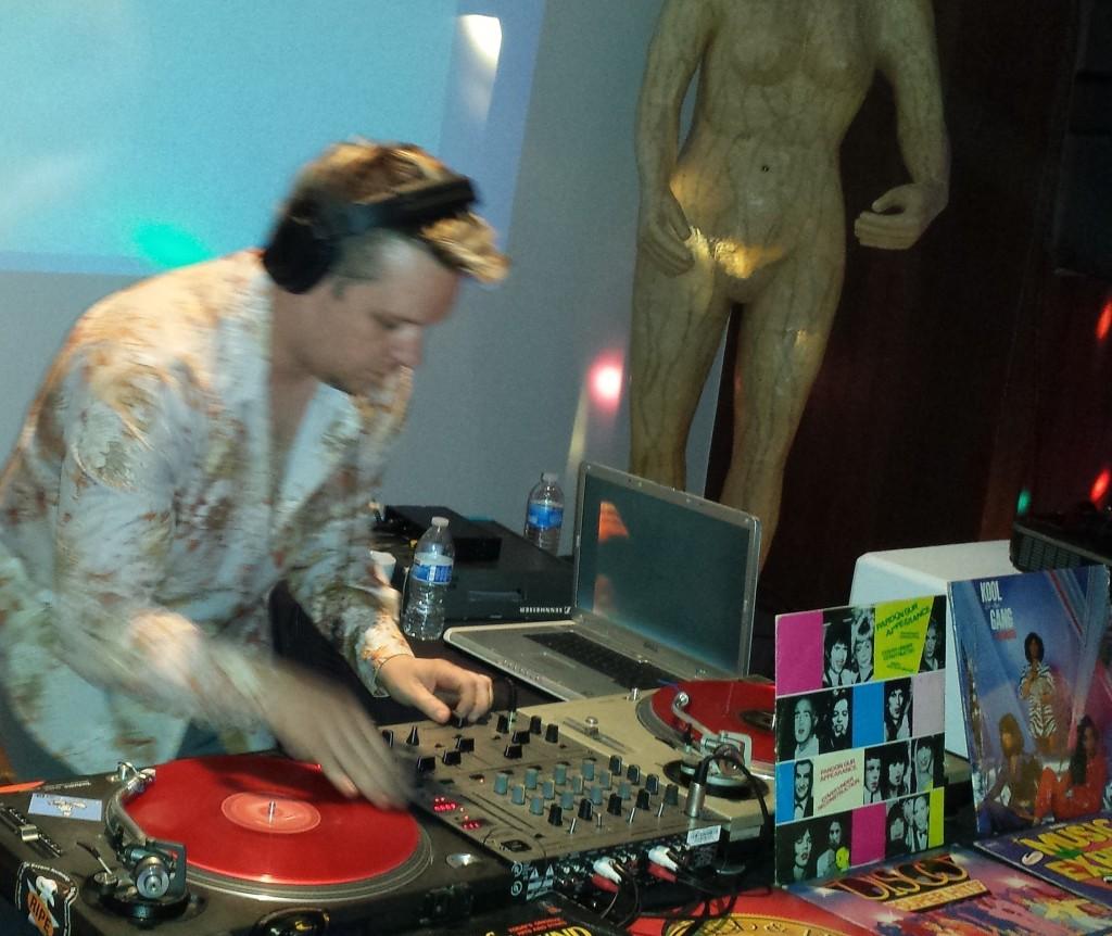 DJ Mancub (Chip Corwin), one of San Francisco's premiere DJ's, set the mood with a steady flow of danceable memorabilia on vintage vinyl.