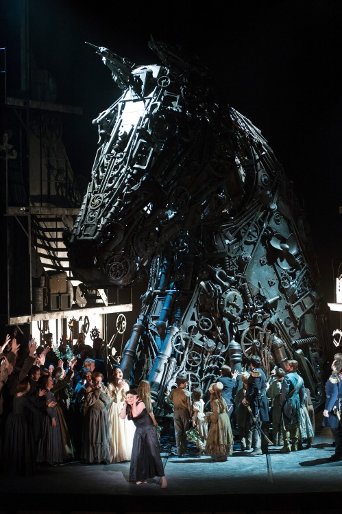 "The version of ""The Trojans"" directed by David McVicar and currently at San Francisco Opera, is set at the time of its composition, in the 1850s, Second Empire France.  All the parts affixed to the Trojan horse look like period tools and scrap metal bits but are custom-pressed fiberglass appliques that are flame resistant and lightweight.  Image from Act I of theRoyal Opera production, directed by David McVicar with set designs by Es Devlin, costume designs by Moritz Junge and lighting design by Wolfgang Göbbel, performed at the Royal Opera House, Covent Garden 22 June 2012. ©Bill Cooper/Royal Opera House"