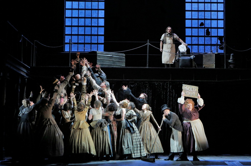"As ACT II opens, the San Francisco Opera Chorus goes wild for Mrs. Lovett's (Stephanie Blythe's) meat pies which have become the talk of Fleet Street. ""God, That's Good"" they belch. Tobias (Matthew Griggs, with broom) helps wait on customers while Sweeney (Brian Mulligan, above) anticipates a custom-made barber chair that will allow him to slash a throat and send the body directly down a chute into the pie shop's bakehouse. Photo: Cory Weaver, SFO"